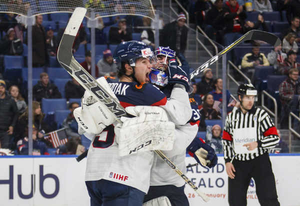 MetaDescription: Slovakia's Martin Bodak and goalie Roman Durny, right, celebrate the team's win over the United States.